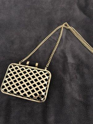 Goldene Clutch aus Samtoptik von H&M