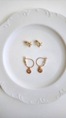 goldene Creolen und Seesterne Ohrringe