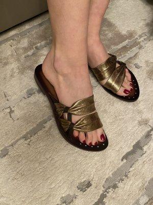 Goldene Flip Flops