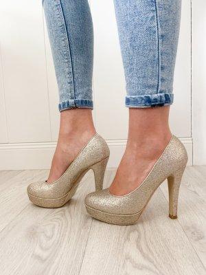 Goldene Glitzer High Heels