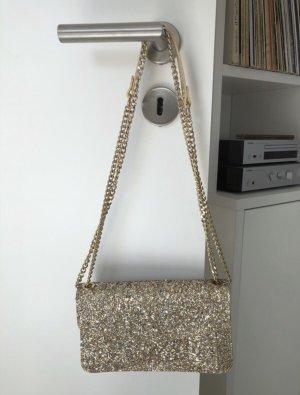 Goldene Glitzertasche