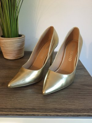 Goldene Pumps