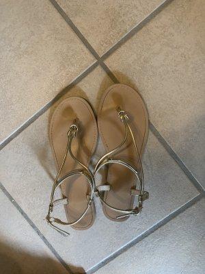 Sandalo toe-post oro-sabbia
