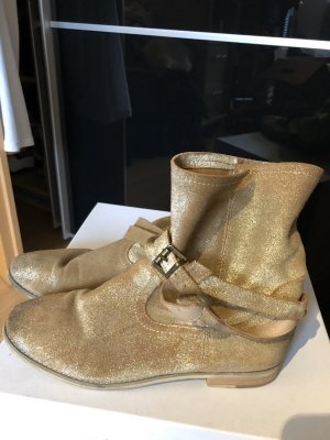 Goldene Stiefeletten mit Riemchen