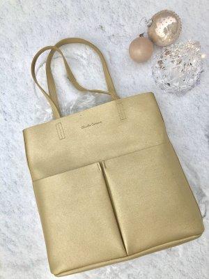 Goldene Tasche von Claudia Canova über ASOS