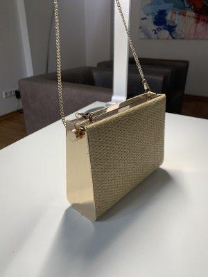 Goldene und gewebte Seitentasche