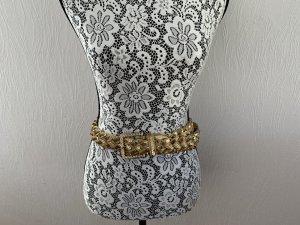 Cinturón trenzado color oro