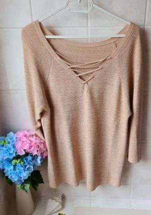 goldener Pullover