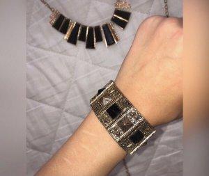 Bracelet en or noir-doré