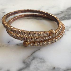 Goldenes Armband mit weissen Strasssteinen