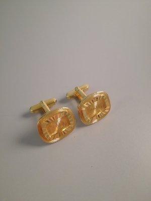 Button gold-colored