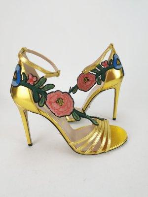 Goldfarbene Sandalen von Gucci