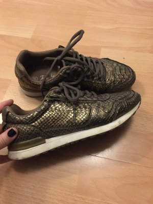Goldfarbene Sneakers