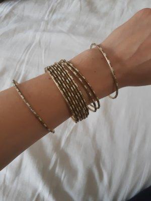 Goldfarbene starre Armbänder / Armreifen