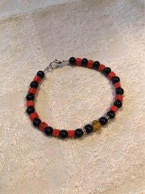 Handarbeit Bracelet en perles rouge brique-bleu foncé