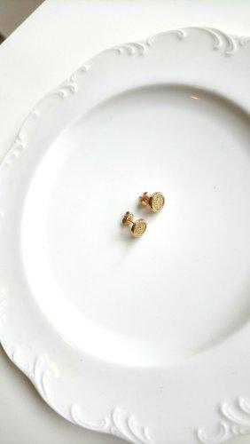 goldgelbe Ohrringe mit glitzernder Fläche