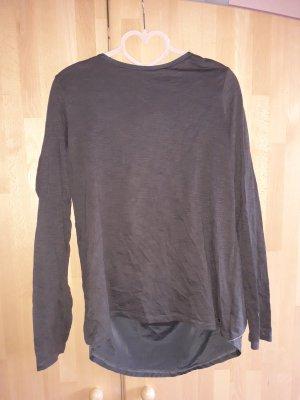 Graue Bluse mit Rückendetails