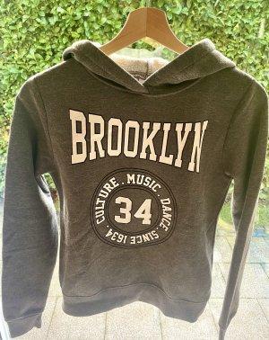 Grauer Brooklyn-Pullover von Ginatricot