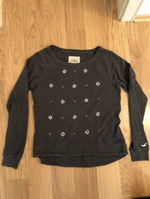 Grauer Pullover mit Glitzer Steinchen von Hollister