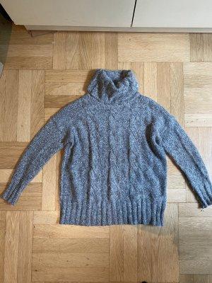 Grauer Rollkragenpullover Wolle
