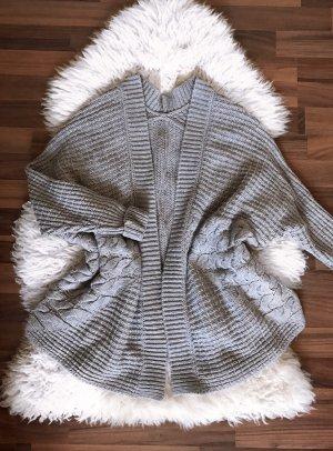 Veste tricotée en grosses mailles gris-gris clair