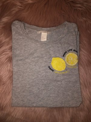 graues tshirt mit lemon patch