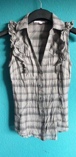 Graukarierte Bluse ohne Ärmel