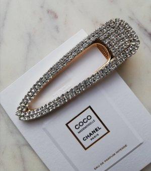 Große Haarspange aus Metall mit Kristallsteinen