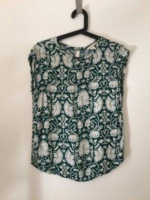 Grün gemusterte Bluse