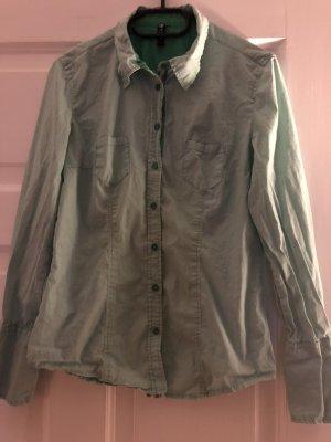 Grün gestreifte Bluse