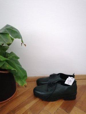 Grüne Leder Schuhe