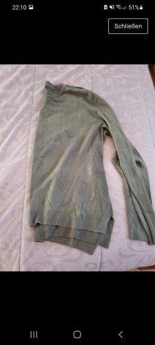 Grüne Pullover