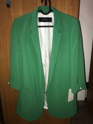 Grüner Blazer mit Perlen bei den Ärmeln