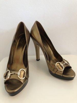 Gucci goldene Plateau peep toes