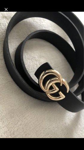Gucci Cinturón pélvico negro-color oro