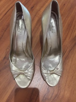 Gucci Plateauzool pumps goud