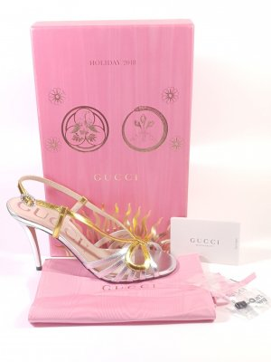 Gucci Strapped pumps gold-colored-silver-colored leather