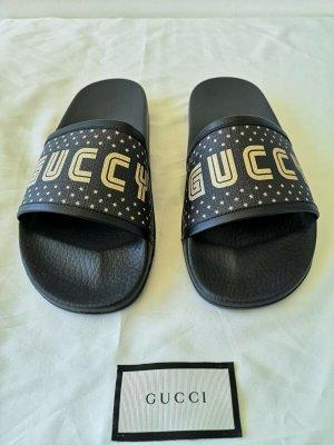 Gucci Sandalias de playa negro-color oro