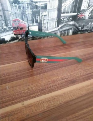 Gucci Ovale zonnebril veelkleurig
