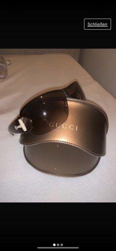 Gucci Lunettes de soleil ovales bronze