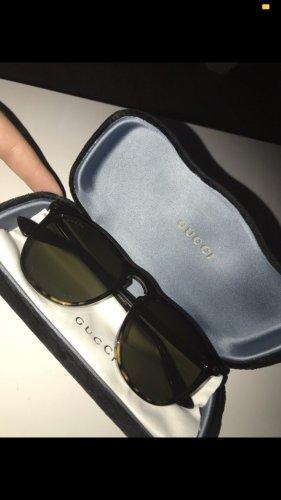 Gucci Occhiale da sole ovale marrone-nero