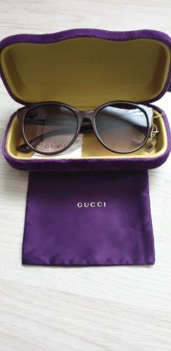 Gucci Occhiale da sole ovale marrone-viola