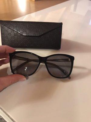 Gucci Hoekige zonnebril zwart-goud