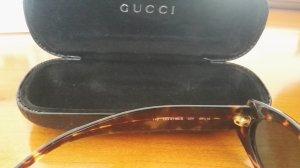 Gucci Lunettes de soleil ovales brun