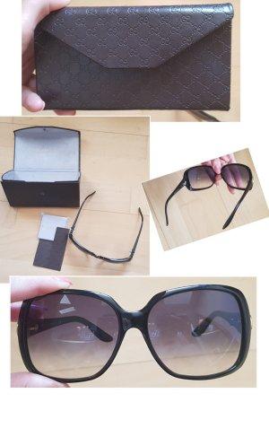 Gucci Lunettes de soleil ovales noir tissu mixte
