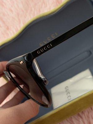 Gucci Ronde zonnebril zwart-goud