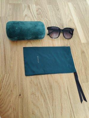 Gucci Sonnenbrille mit gestreiftem Bügel