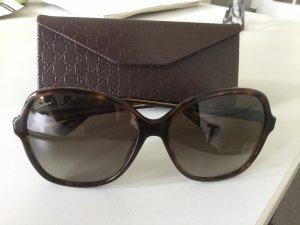 Gucci Hoekige zonnebril zwart bruin