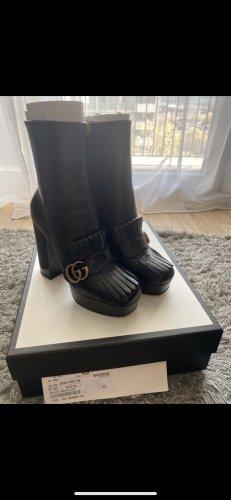 Gucci Stivaletto con plateau nero-oro