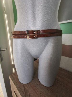 Hebilla del cinturón marrón